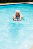 Senior woman swimming in the pool Stock Photo