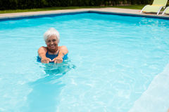 Senior woman swimming in the pool Royalty Free Stock Images