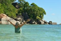 Senior woman swimming in sea Stock Images