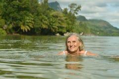 Senior woman swimming at  sea Royalty Free Stock Images