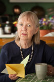 Senior woman with sympathy card Royalty Free Stock Image