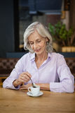 Senior woman at table in cafe Royalty Free Stock Photos