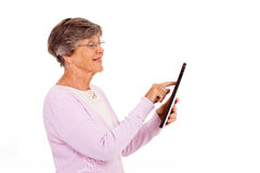 Senior woman tablet Stock Images