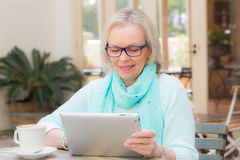 Senior woman tablet Stock Image
