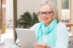 Senior woman tablet Royalty Free Stock Image