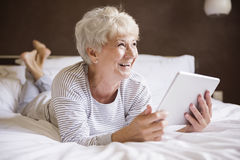 Senior woman with tablet Stock Photo