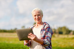 Senior woman with tablet pc computer at county stock image