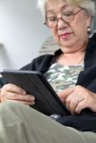 Senior woman with tablet royalty free stock image