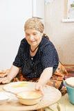 Senior woman taking bowl Royalty Free Stock Photo