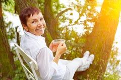 Senior woman taking a break with tea Stock Photos