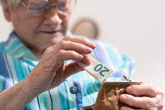 Free Senior Woman Taking Out A Banknote From Her Wallet Royalty Free Stock Image - 92292426