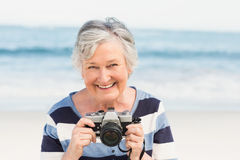 Senior woman taking picture Royalty Free Stock Images