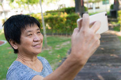 Senior woman taking selfie Royalty Free Stock Photos