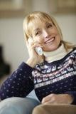 Senior woman talking on cordless phone at home Stock Photo
