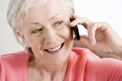 A senior woman talking on a mobile phone Stock Photos