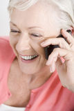 A senior woman talking on a mobile phone Royalty Free Stock Images