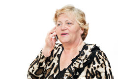 Senior woman talking on mobile phone at home isolated on white background Stock Photos
