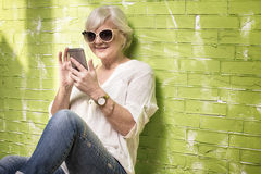 Senior woman talking by mobile phone. Royalty Free Stock Image