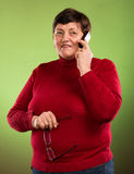 Senior woman talking on mobile phone Stock Images