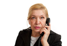 Senior Woman talking on the phone Stock Photo