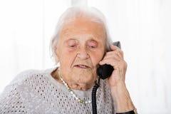 Senior Woman Talking On Phone royalty free stock image