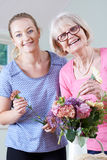 Senior Woman With Teacher In Flower Arranging Class Stock Image