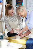 Senior Woman With Teacher In Pottery Class Royalty Free Stock Photo