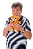 Senior woman with teddy Stock Photos