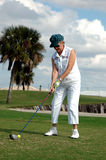 Senior woman tee off Stock Image