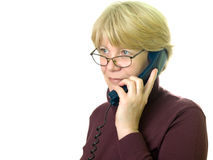 A senior woman at telephone stock images