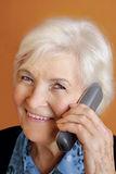 Senior woman with telephone stock photography