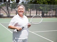 Senior Woman Tennis Player. Active senior woman on the tennis courts Royalty Free Stock Image