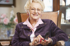 Senior woman text messaging Stock Photo