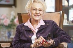 Senior woman text messaging. Portrait Of Senior woman text messaging Stock Photo