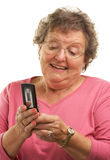 Senior Woman Texting on Cell Phone Royalty Free Stock Photography