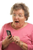 Senior Woman Texting on Cell Phone Stock Photo