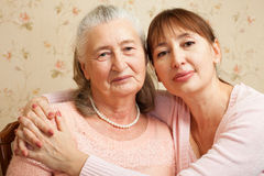 Senior woman with their caregiver at home. Stock Photo