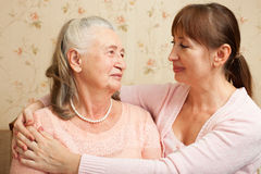 Senior woman with their caregiver at home. Stock Image