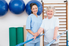 Senior woman and therapist looking at camera Stock Photography