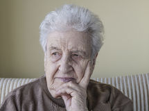 Senior woman thinking. A lovely senior woman thinking royalty free stock images