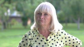 Senior woman threatening with fist. stock footage