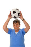 Senior woman throwing a ball Stock Photos