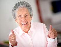 Senior woman with thumbs up Stock Photography
