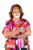 Senior woman with tiger face-paint royalty free stock photos