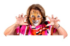 Senior woman with tiger face-paint stock photography