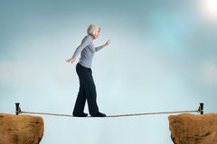 Senior woman tightrope Stock Photography