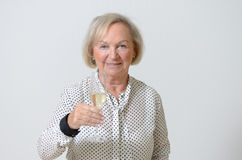 Senior woman toasting with champagne Stock Image