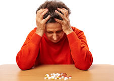 Senior woman with too many pills Royalty Free Stock Photos