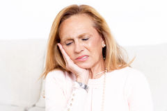 Senior woman with tooth ache royalty free stock photography