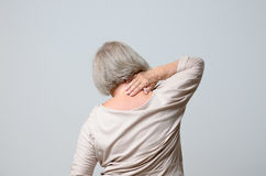Senior woman touching her neck Royalty Free Stock Photography